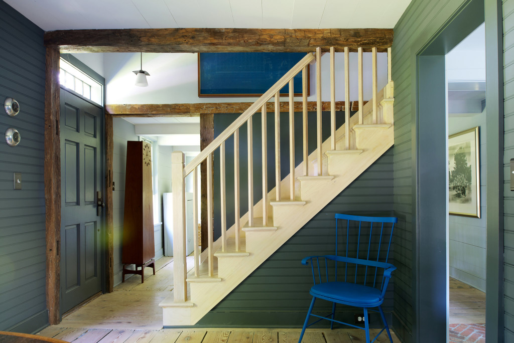 Unstained staircase, painted hallway